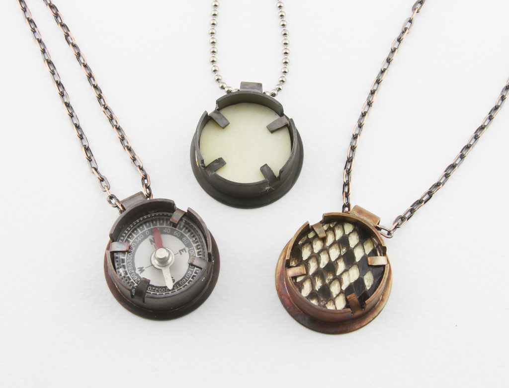 compass, piano-key ivory, and snake skin set in deep bezels
